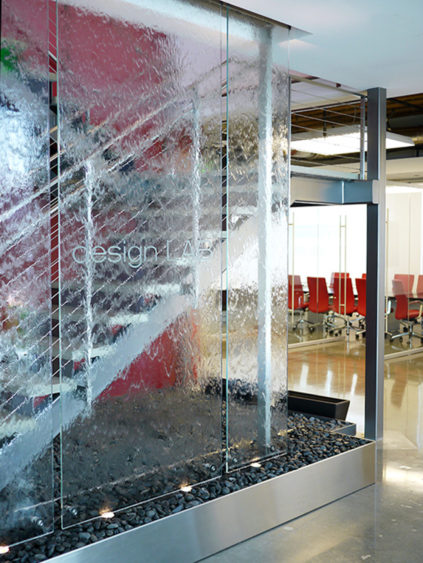An Innovative Glass Water Wall Stands In Front Of A Staircase In The Entry  Lobby Of The New Design LAB Headquarters In Gardena, California.